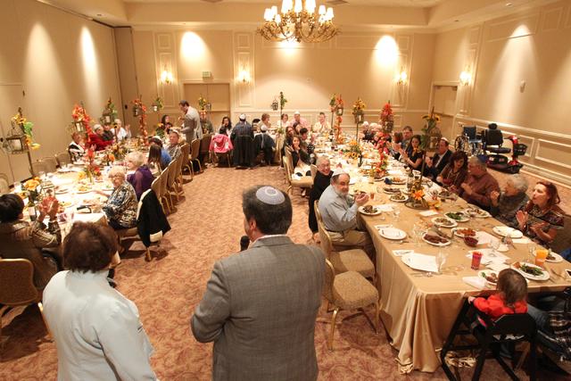 Rabbi Felipe Goodman introduces caterer Madeline Morris during Thanksgivukkah at Temple Beth Sholom in Las Vegas Thursday, Nov. 28, 2013. (K.M. Cannon/Las Vegas Review-Journal)