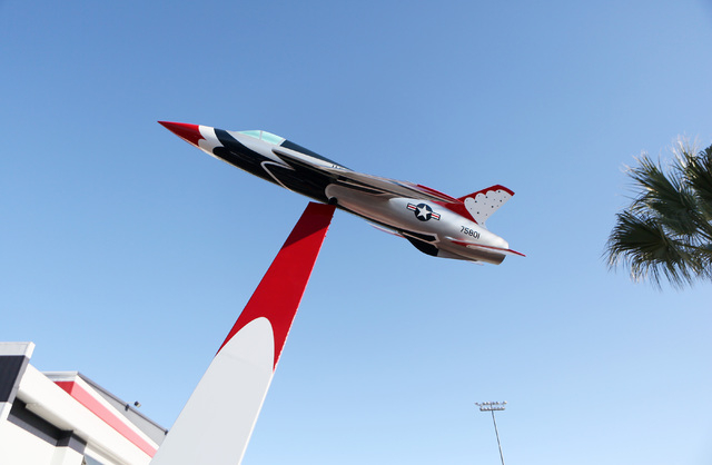 A one-twelfth scale model of a Republic Aviation's F-105 is erected outside the Thunderbirds Hangar at Nellis Air Force Base Friday, Nov. 15, 2013, in Las Vegas. The model jet was rededicat ...