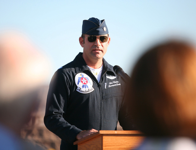 Lt. Col. Greg Moseley (CQ) speaks during a rededication ceremony for Capt. Gene Devlin outside the Thunderbirds Hangar at Nellis Air Force Base Friday, Nov. 15, 2013, in Las Vegas. A one-twelfth s ...