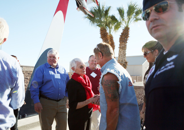Shirley Buckley, center, shakes hands with Rick Dale during a rededication ceremony for her late husband Capt. Gene Devlin outside the Thunderbirds Hangar at Nellis Air Force Base Friday, Nov. 15, ...