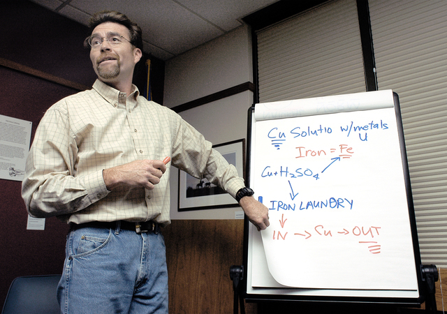 Earle Dixon explains the chemical processes used to extract copper at the former Anaconda mine in Yerington on Dec. 8, 2004. Dixon, who said he was fired by the Bureau of Land Management for refus ...