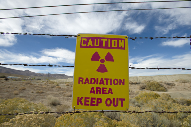 A sign gives a warning at the former Anaconda copper mine site near Yerington. After decades of state and mine officials claiming that radiation and arsenic contamination in the local wells occurr ...