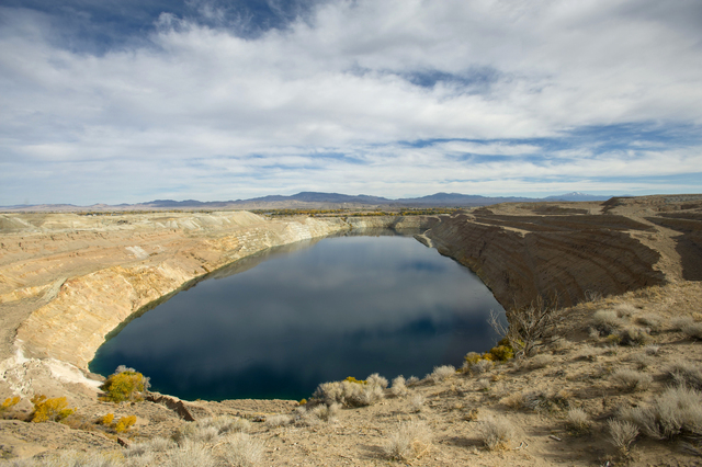 A water-filled mine pit at the former Anaconda copper mine site near Yerington tested as high as 100 times above the legal drinking water standard for uranium or arsenic or both. (AP Photo/Scott S ...