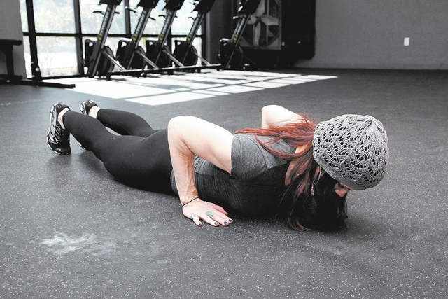 Trainer Laura Salcedo demonstrates the starting position for the close grip push-up at Mountains Edge CrossFit in Las Vegas on Tuesday, Oct. 29, 2013. (Justin Yurkanin/Las Vegas Review-Journal)