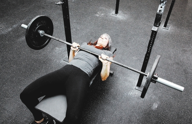 Trainer Laura Salcedo demonstrates the finishing position for the close grip bench press at Mountains Edge CrossFit in Las Vegas on Tuesday, Oct. 29, 2013. (Justin Yurkanin/Las Vegas Review-Journal)