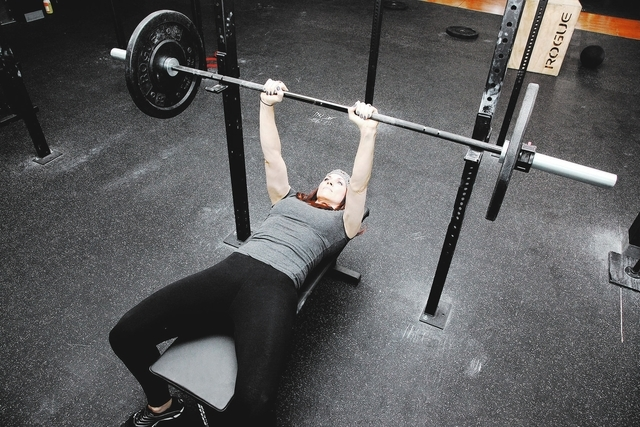 Trainer Laura Salcedo demonstrates the starting position for the close grip bench press at Mountains Edge CrossFit in Las Vegas on Tuesday, Oct. 29, 2013. (Justin Yurkanin/Las Vegas Review-Journal)