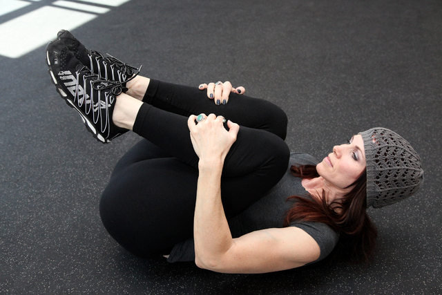 Trainer Laura Salcedo demonstrates the starting position for the lower back stretch at Mountains Edge CrossFit in Las Vegas on Tuesday, Oct. 29, 2013. (Justin Yurkanin/Las Vegas Review-Journal)