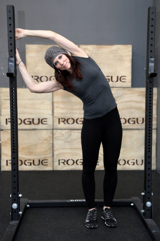 Trainer Laura Salcedo demonstrates the finishing position for the lat stretch at Mountains Edge CrossFit in Las Vegas on Tuesday, Oct. 29, 2013. (Justin Yurkanin/Las Vegas Review-Journal)