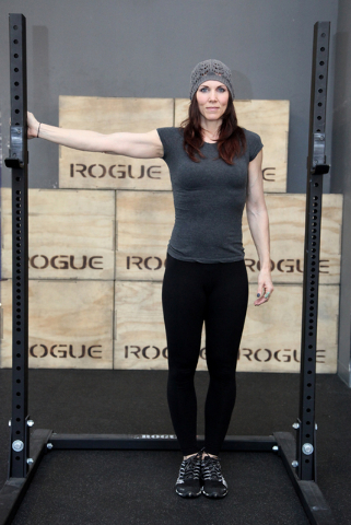 Trainer Laura Salcedo demonstrates the starting position for the lat stretch at Mountains Edge CrossFit in Las Vegas on Tuesday, Oct. 29, 2013. (Justin Yurkanin/Las Vegas Review-Journal)