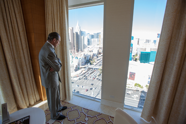 Tropicana Las Vegas CEO Alex Yemenidjian looks down on the Las Vegas Strip from one of the newly renovated Sky Villas on the 20th floor of the Tropicana Las Vegas on Monday, Nov. 25, 2013. (Chase  ...