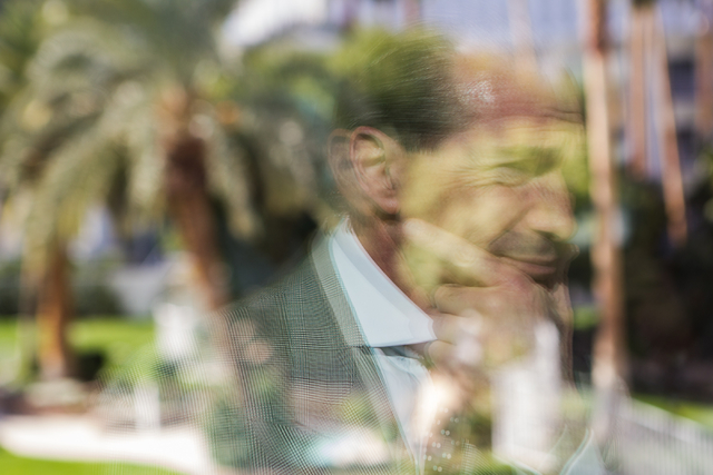 Tropicana Las Vegas CEO Alex Yemenidjian, reflected in glass, looks out at the pool area at the Tropicana Las Vegas on Monday, Nov. 25, 2013. (Chase Stevens/Las Vegas Review-Journal)