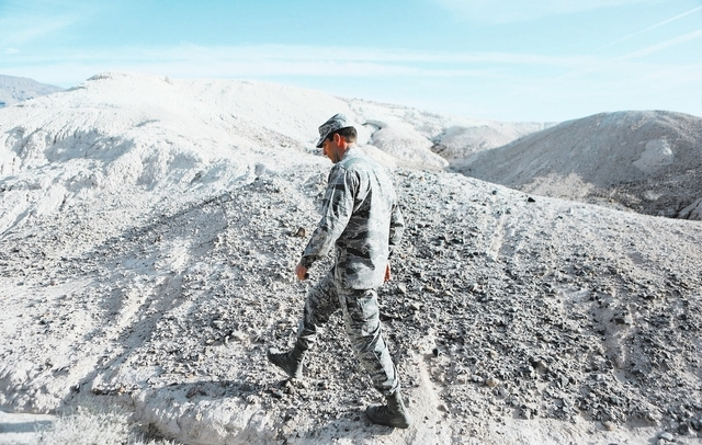 U.S. Air Force Colonel Barry Cornish walks along the uneven terrain of Tule Springs Fossil Beds National Monument during a private tour Monday, Nov. 18, 2013, in North Las Vegas. A bill is current ...