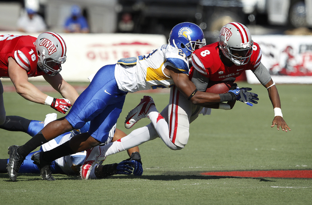 UNLV quarterback Caleb Herring gets sacked by Bene Benwikere of San Jose State during their football game at Sam Boyd Stadium in Las Vegas Saturday, Nov. 2, 2013. (John Locher/Las Vegas Review-Jou ...