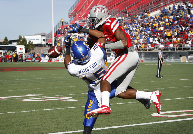 UNLV defensive back Kenneth Penny breaks up a touchdown pass intended for Tyler Winston of San Jose State during their football game at Sam Boyd Stadium in Las Vegas Saturday, Nov. 2, 2013. (John  ...