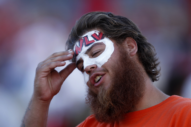 A UNLV fan reacts while watching his team against San Diego State during their football game at Sam Boyd Stadium in Las Vegas Saturday, Nov. 2, 2013. (John Locher/Las Vegas Review-Journal)