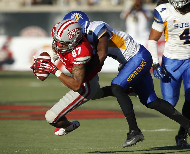 UNLV wide receiver Maika Mataele makes a reception against San Diego State during their football game at Sam Boyd Stadium in Las Vegas Saturday, Nov. 2, 2013. (John Locher/Las Vegas Review-Journal)