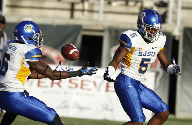 San Jose State Dasheon Frierson, right, misses an interception attempt during their football game against UNLV at Sam Boyd Stadium in Las Vegas Saturday, Nov. 2, 2013. (John Locher/Las Vegas Revie ...