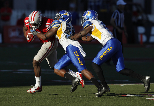 UNLV wide receiver Devante Davis, left, runs for a gain against San Jose State during their football game at Sam Boyd Stadium in Las Vegas Saturday, Nov. 2, 2013. (John Locher/Las Vegas Review-Jou ...