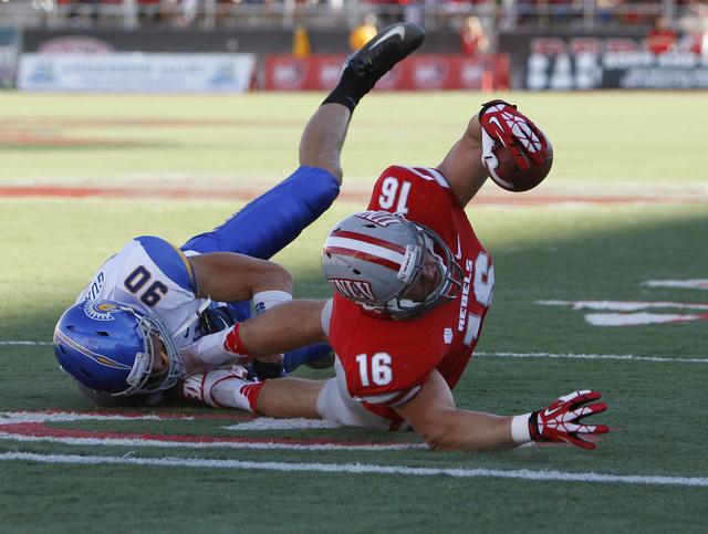 UNLV player Taylor Barnhill gets tackled just short of the end zone by Garrett Guanella of San Jose State during their football game at Sam Boyd Stadium in Las Vegas Saturday, Nov. 2, 2013. (John  ...