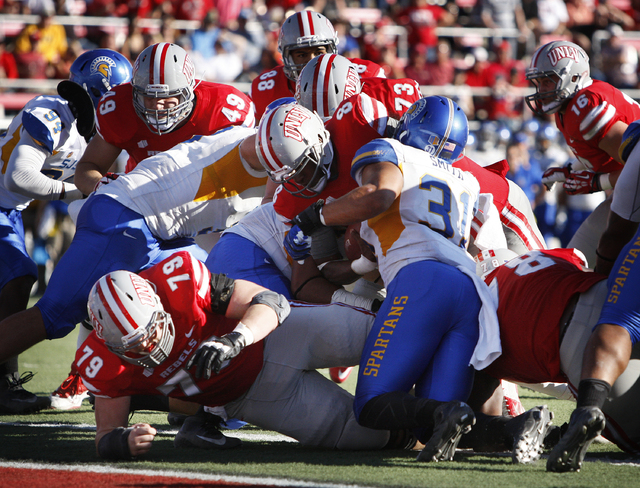 UNLV quarterback Caleb Herring, 8, scores a touchdown against San Diego State during their football game at Sam Boyd Stadium in Las Vegas Saturday, Nov. 2, 2013. (John Locher/Las Vegas Review-Journal)