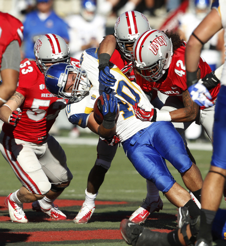 Jarrod Lawson of San Jose State gets tackled by UNLV during their football game at Sam Boyd Stadium in Las Vegas Saturday, Nov. 2, 2013. (John Locher/Las Vegas Review-Journal)