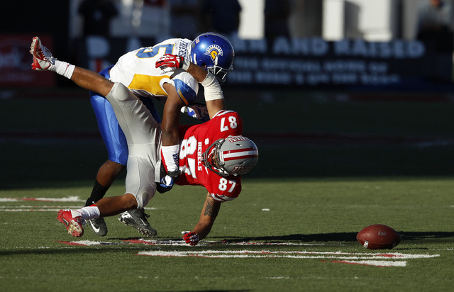 Dasheon Frierson of San Jose State breaks up a pass intended for Maika Mataele of UNLV during their football game at Sam Boyd Stadium in Las Vegas Saturday, Nov. 2, 2013. (John Locher/Las Vegas Re ...