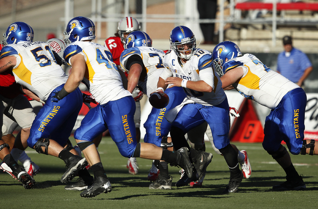 Quarterback David Fales of San Jose State hands off the ball against UNLV during their football game at Sam Boyd Stadium in Las Vegas Saturday, Nov. 2, 2013. (John Locher/Las Vegas Review-Journal)