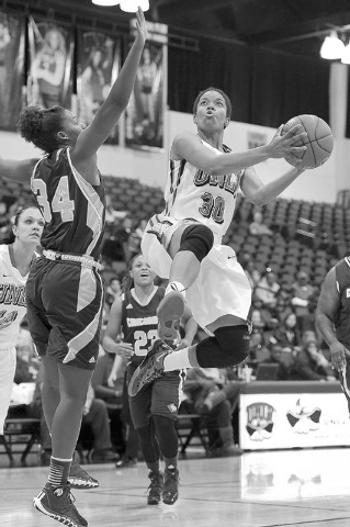 UNLV's Mia Bell (30) goes up for a layup against Condordia defender Jade Reed (34) during an exhibition basketball game at the Cox Pavilion in Las Vegas Monday, Nov. 4, 2013. (David Cleveland/Las  ...