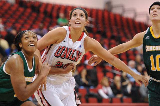 UNLV's Alana Cesarz (24) fights for a rebound against Concordia's Brittany Stafford (0) during an exhibition game at the Cox Pavilion on Nov. 4. (David Cleveland/Las Vegas Review-Journal)