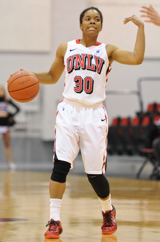 UNLV's Mia Bell (30) dribbles the ball during an exhibition basketball game against Concordia at the Cox Pavilion in Las Vegas Monday, Nov. 4, 2013. (David Cleveland/Las Vegas Review-Journal)