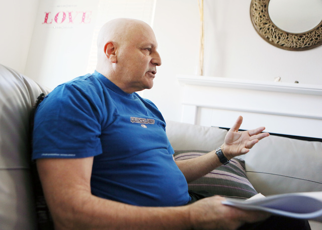 Las Vegas USO volunteer Jack Ross speaks during a home interview Monday, Nov. 25, 2013, in Las Vegas. Ross is unhappy to learn that the USO's national director earned $559,401 in 2012. Ross said t ...