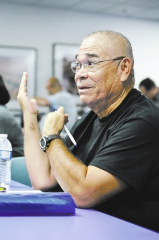 Retired U.S. Air Force Staff Sgt. Samuel Villalpando asks a question during an orientation meeting for veterans at the College of Southern Nevada Charleston Campus, 6375 W. Charleston Blvd., in La ...