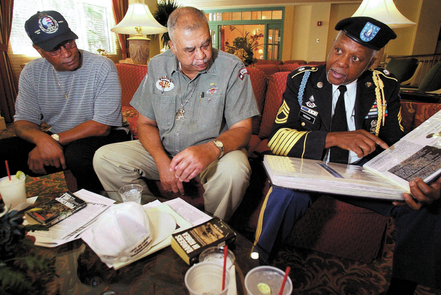 Korean War veterans, from left, Bill Miller, Ed Posey and Larry Hogan talk about their service on Pork Chop Hill during a reunion at the Hilton Vacation Resort Wednesday, Sept. 10, 2003. It was th ...