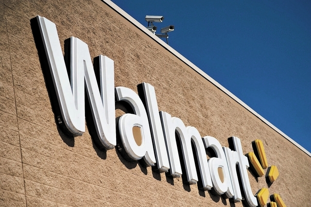 A sign hangs outside a Wal-Mart store in East Peoria, Illinois, U.S., on Wednesday, Feb. 20, 2013. Wal-Mart Stores Inc., the worlds largest retailer, projected first-quarter profit that trailed an ...