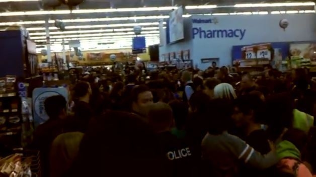 A crowd surrounds a pallet of tablets Thursday at a Walmart in Clinton, Utah, where a woman was trampled by fellow shoppers. (Utah VOD/YouTube)