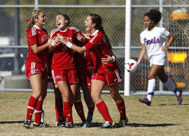 Arbor View High School soccer players celebrate a goal by Lexi Epley (3) during the Sunset Region championship game in Henderson, Nev. Saturday, Nov. 9, 2013. (John Locher/Las Vegas Review-Journal)
