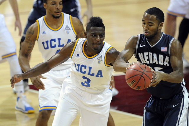 UCLA Bruins guard Jordan Adams, left, tries to steal the ball away from Nevada Wolf Pack guard D.J. Fenner in the first half of their NCAA Basketball game in the Las Vegas Invitational college bas ...