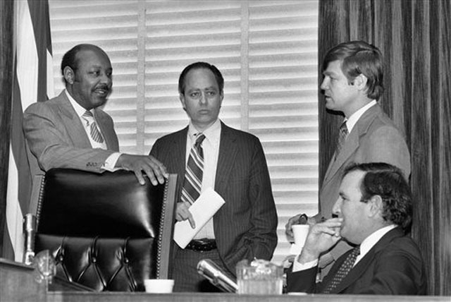 On Dec. 22, 1978, House Assassinations Committee chief counsel G. Robert Blakey, second left, meets with committee chairman Louis Stokes, D-Ohio, left, before the panel went into closed session in ...