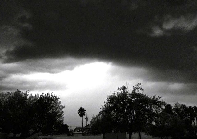 Ominous clouds frame the Stratosphere Tower in the distance as rain falls in the valley. (Courtesy, Edith Galicia)