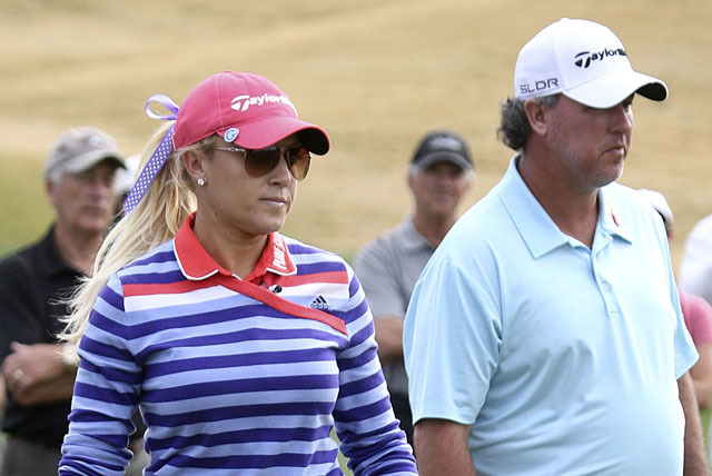Natalie Gulbis and Boo Weekly watch Gulbis's ball on the 11th fairway during the Wendy's 3-Tour Challenge at the Rio Secco Golf Club in Henderson, Tuesday, Nov. 12, 2013. (Jerry Henkel/Las Vegas R ...