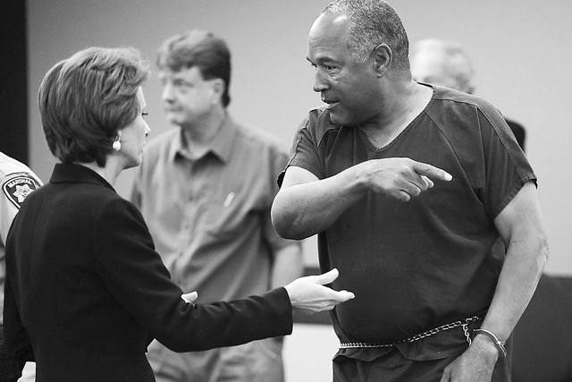 O.J. Simpson, right, talks to his defense attorney Patricia Palm during a break in the second day of  an evidentiary hearing in Clark County District Court, Tuesday, May 14, 2013 in Las Vegas.  Th ...