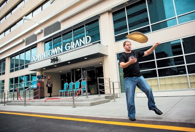 Siler Chapman (cq), a chef at Pizza Rock, tosses pizza dough after the ribbon cutting ceremony of the Downtown Grand Las Vegas, located at 206 N. 3rd Street, Tuesday, Nov. 12, 2013. The urban hote ...