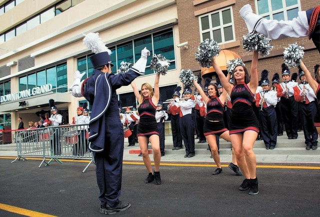 The Valley High School band and cheerleaders perform during the ribbon cutting ceremony of the Downtown Grand Las Vegas, located at 206 N. 3rd Street, Tuesday, Nov. 12, 2013. The urban hotel-casin ...