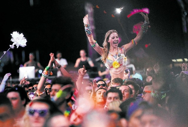 Festival goers dance during Insomniac's Electric Daisy Carnival at the Las Vegas Motor Speedway on June 21, 2013. (Jason Bean/Las Vegas Review-Journal)
