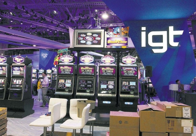 The new IGT logo is seen at the IGT booth at the G2E convention in the Sands Expo in Las Vegas, Monday, Sept. 23, 2013. G2E opens on Tuesday, Sept. 24, 2013. (File, JERRY HENKEL/LAS VEGAS REVIEW-J ...
