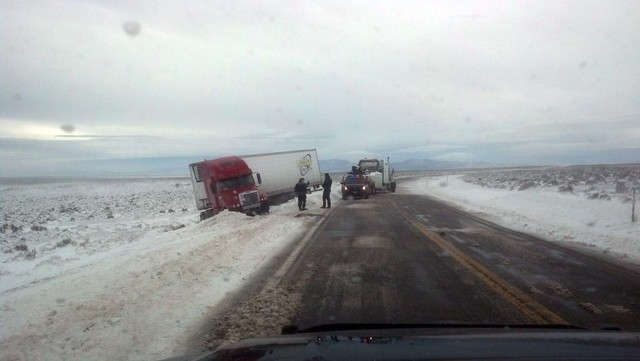 Emergency vehicles respond to help with a tractor-trailer rig went off the highway in a snowstorm between Ely and Pioche on Friday. (Courtesy, Nevada Highway Patrol, Elko)