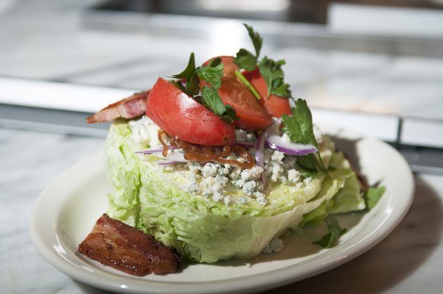 The wedge is served with bacon, blue cheese, red onion and marinated tomatoes at Michael Mina's Pub 1842 inside the MGM Grand. (Erik Verduzco/Las Vegas Review-Journal)