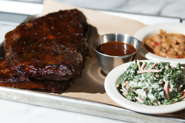 A plate of the St. Louis ribs is served with beans and kale slaw at Michael Mina's Pub 1842 inside the MGM Grand. (Erik Verduzco/Las Vegas Review-Journal)