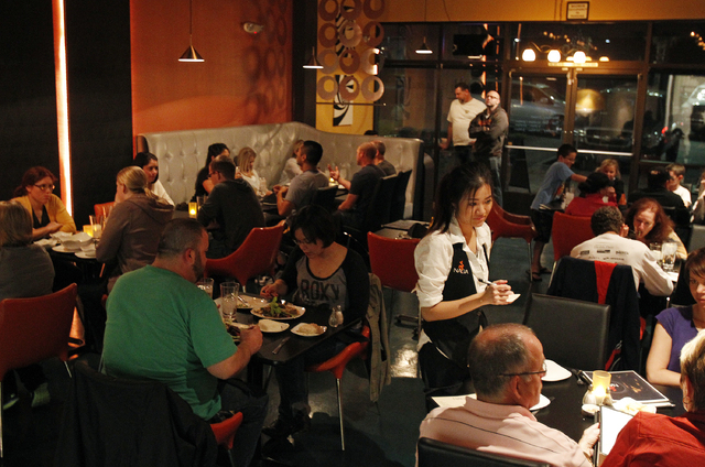 Diners fill the tables at Naga Thai in Henderson, Nev. Saturday, Nov. 9, 2013. (John Locher/Las Vegas Review-Journal)