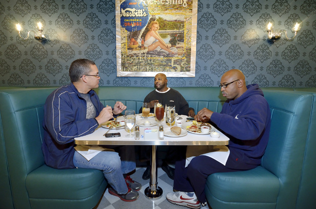 Craig Kirkland, left, Dwayne Ross and AJ Thompson dine at the Stewart + Ogden diner bistro in the Downtown Grand. (Bill Hughes/Las Vegas Review-Journal)
